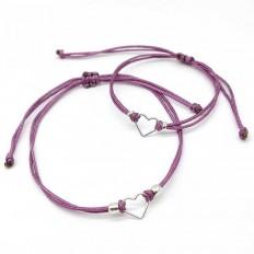 Dos pulseras para mama e hija, de hilo de color  y un corazon en medio en plata ley