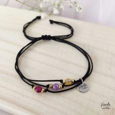pulsera negra con plaquita de acero kerete y piedras de colores